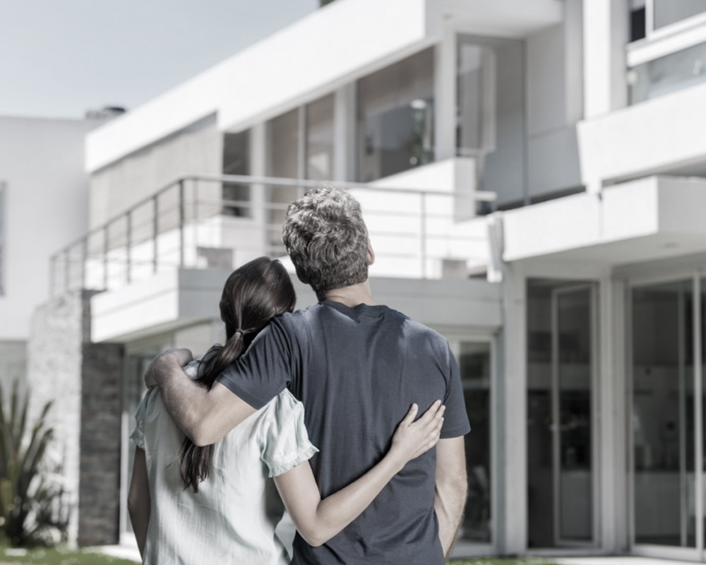 young couple looking at their new home, showcasing Irena Skoda design architects and interior designers' design build process